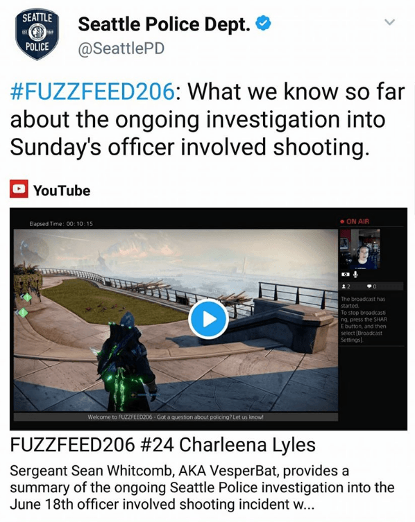 "Image depicts a Tweet made by the Seattle PD that shows an image of Sergeant Sean Whitcomb playing a first-person shooter video game. Above the image reads: ""#FUZZFEED206: What we know so far about the ongoing investigation into Sunday's officer involved shooting."" Below the image reads: ""FUZZFEED #24 Charleena Lyles. Sergeant Sean Whitcomb, AKA VesperBat, provides a summary of the ongoing Seattle Police investigation into the June 18th officer involved shooting incident w..."""
